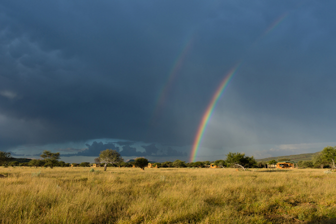 Rainbow_with_view_rooms_in_background_fs